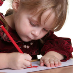 young pretty girl learn drawing with pencil